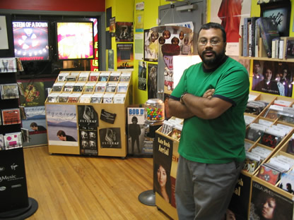 Nayan Bhula in the front room of his store, Revolution Records in Van Ness